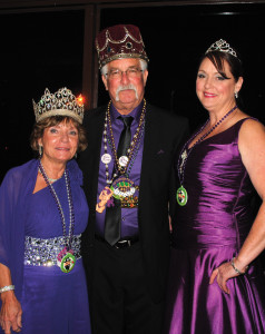Krewe du Lac 2015 King and Queen Larry and Betty Hays, left, join Princess Connie Mack for a photo at the Royal Ball at Landry's in Kemah.