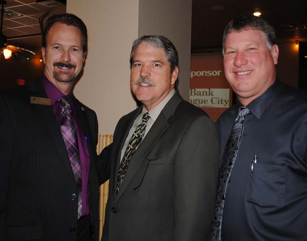 League City Mayor Tim Paulissen, left, welcomes State Sen. Larry Taylor, center, and Galveston County Sheriff Henry Trochesset to the League City Chamber State of the City Luncheon at La Brisa.