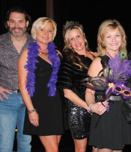 Mardi Gras revelers, Mark Lovfald, Bobbie Coan, Shannon Alexander and Debbie Salisbury, from left, were among the arriving crowd at the Kemah Krewe du Lac's Royal Ball.
