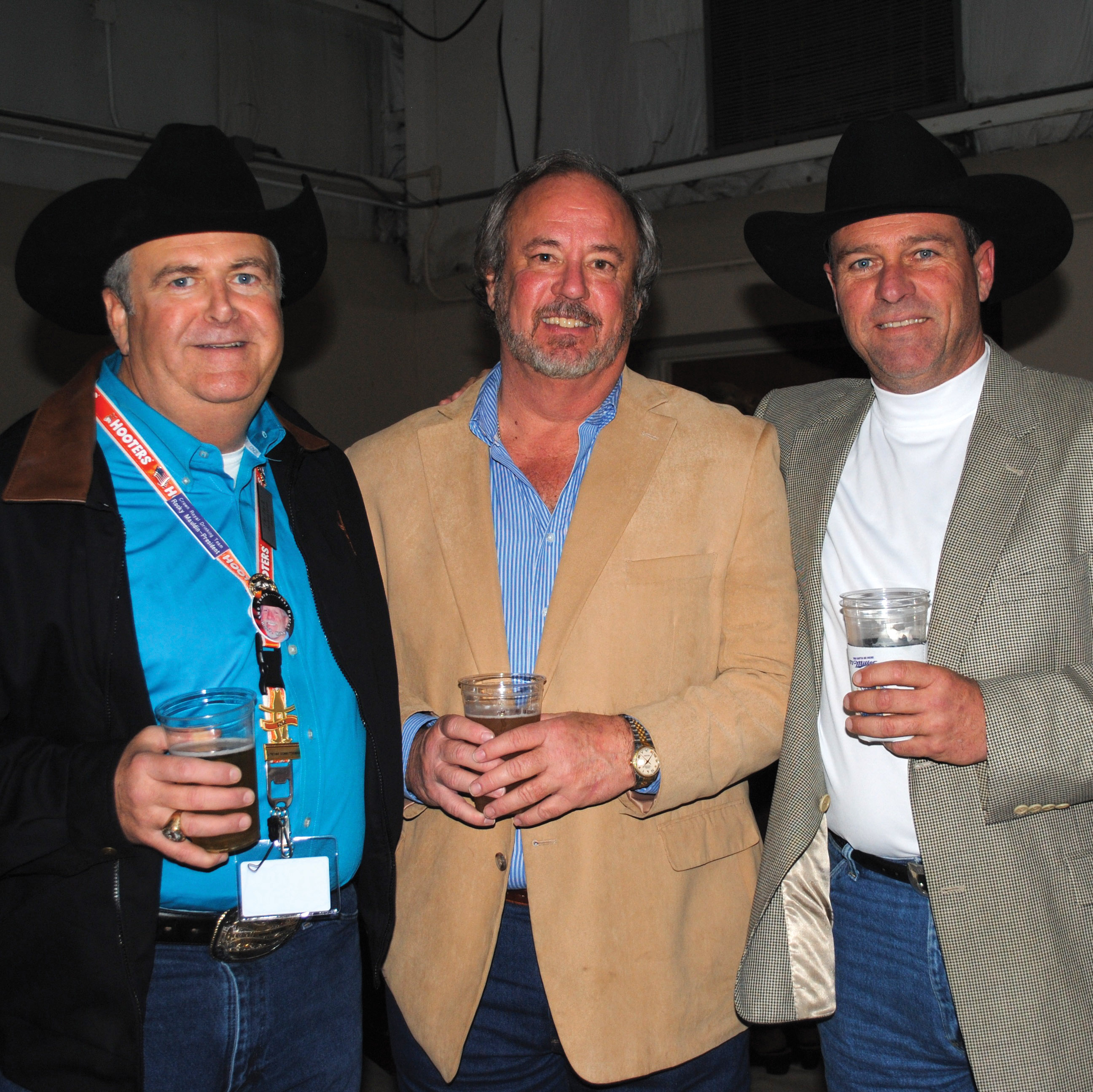 Rocky Mauldin, Steve Kirk and Jeff DeWease, from left, talk over old times at  the Rodeo Style Show.