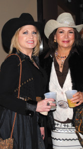 Tamra Gann Curry, left, and Kathleen Courville arrive at NASA's Gilruth Center for the Go Texan Rodeo Style Show.