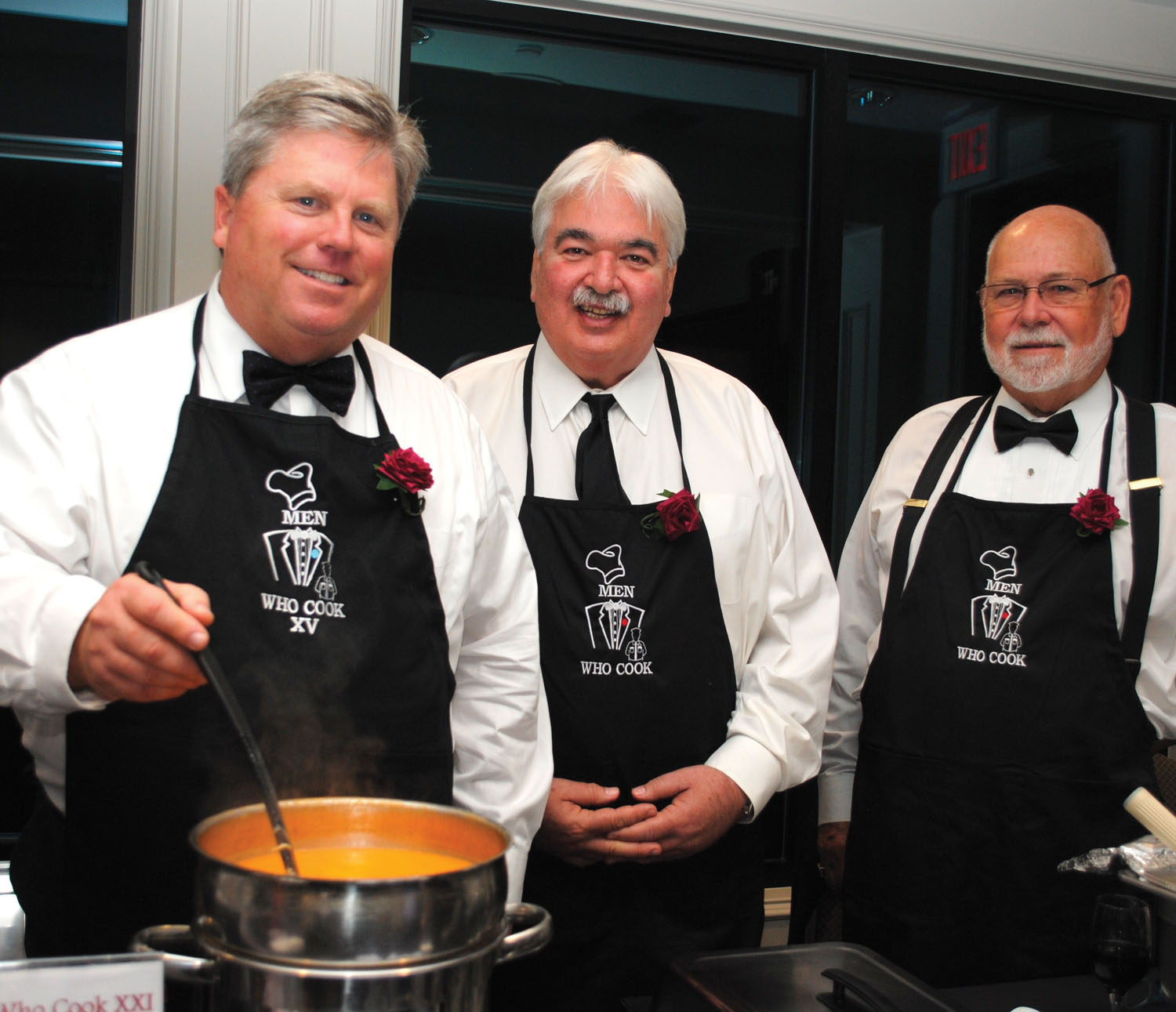 Trey Hafely, stirs his Lobster Bisque, as Rick Clapp, center, and Bobby Horton look on during the Seabrook Men Who Cook at Lakewood Yacht Club. This is Hafely's 13th year as a chef and Clapp's 20th year.