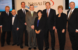 Angela Braun, center, has been appointed by the Nassau Bay City Council to fill the seat held by her late husband, Mayor Pro-tem David Braun, until the May election. Joining her for photos after the vote are, from left, City Attorney Dick Gregg Jr., and Councilors Bob Warters, Jonathan Amdur, Bruce Klug, Mayor Mark Denman, Sandra Mossman and John Mahon.