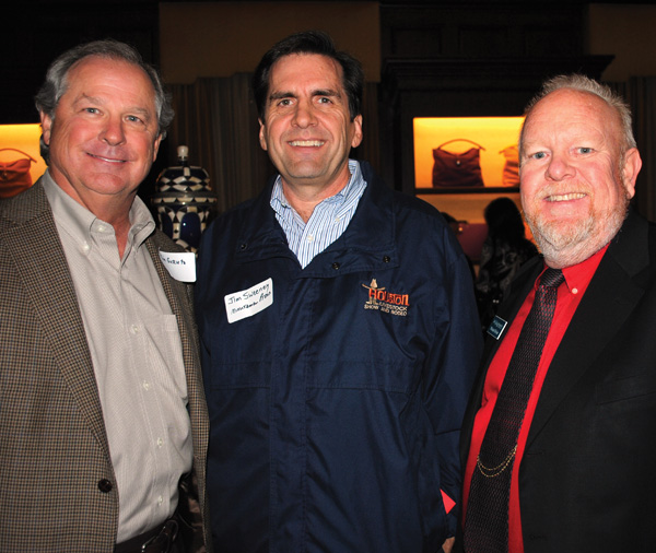 First Financial Benefits President Rick Gornto, from left, stops to say hello to past Clear Lake Area Chamber Chairmen Jim Sweeney and Michael Divine at the Men Go Red for Women benefit at the West Mansion.