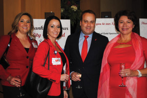 Bay Area Regional Medical Center Chairman Dr. Michael Lyons and his wife, Loraine, right, visit with Monica MacKerron, from left, and Nacole Beasley, R.N., as the crowd begins arriving for the 2015 Go Red for Women Luncheon at South Shore Harbour Resort in League City.
