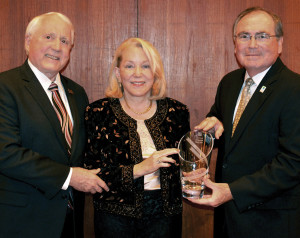UHCL President William Staples, right, presents the 2015 President's Cabinet Leadership Award to Pat and Wendell Wilson during President's Cabinet Dinner.
