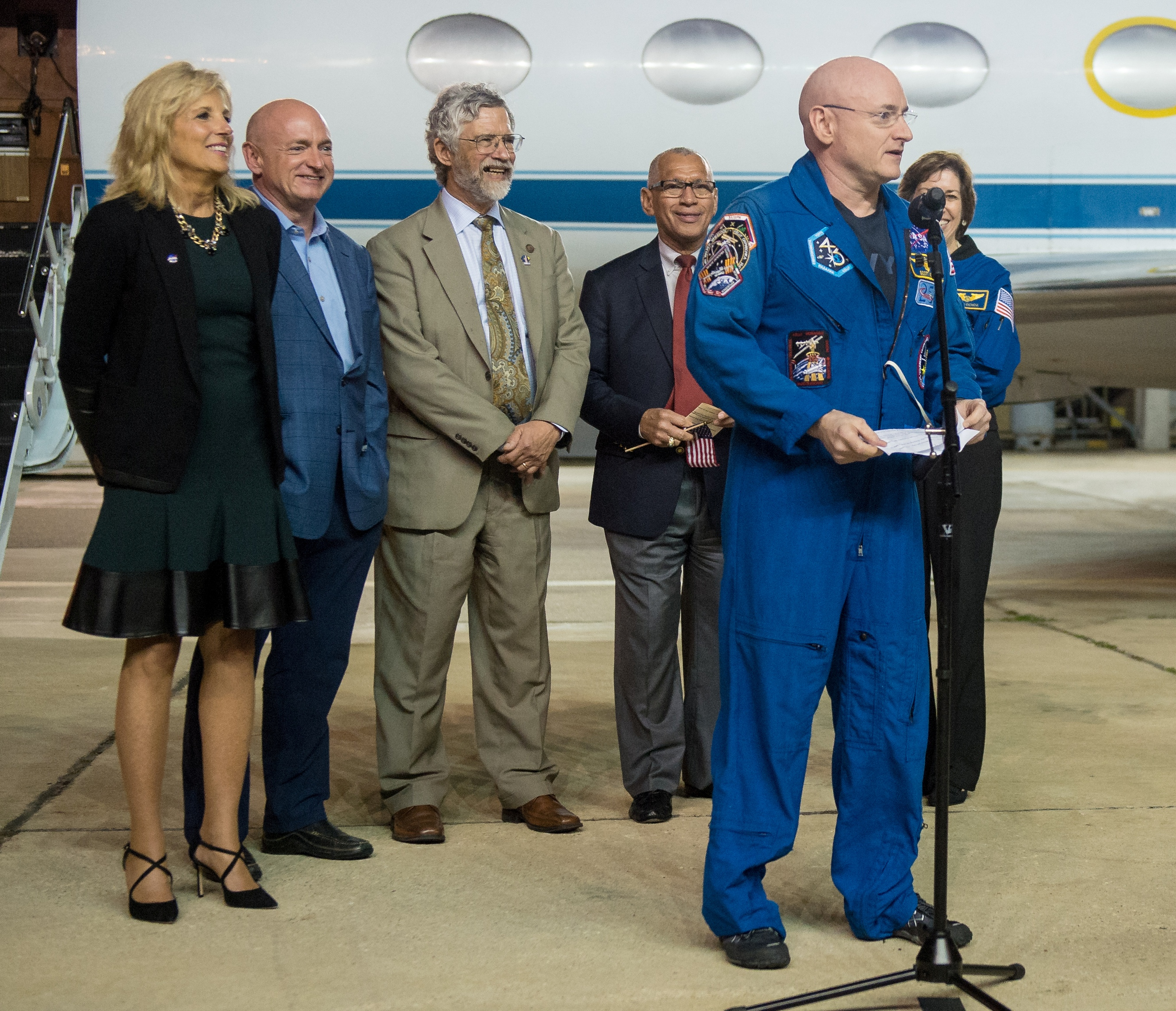 Astronaut Scott Kelly addresses the crowd that came to greet him at Ellington Field Wednesday, March 2, after spending a year in space. Helping welcome him back to Houston following his return to Earth were, from left, Dr. Jill Biden, wife of Vice President Joe Biden; his twin brother, retired astronaut Mark Kelly; Dr. John Holdren, director of the White House Office of Science and Technology; NASA Administrator Charles Bolden; and Johnson Space Center Director Dr. Ellen Ochoa.
