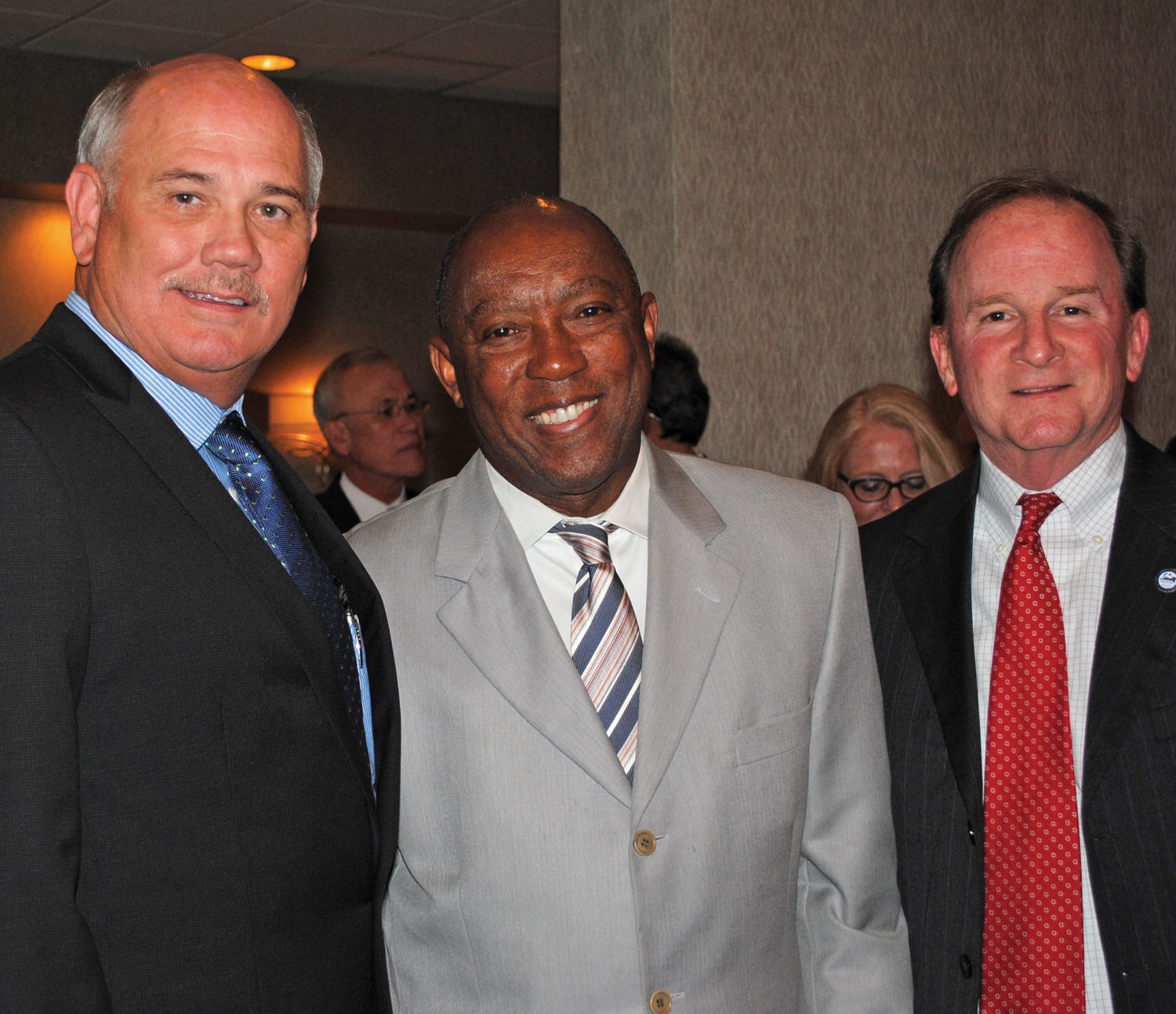 Bay Area Houston Economic Partnership President Bob Mitchell, left, and Houston City Councilman Dave Martin, right, welcome Houston Mayor Sylvester Turner to the BAHEP reception – his third visit to Clear Lake since becoming mayor in January.