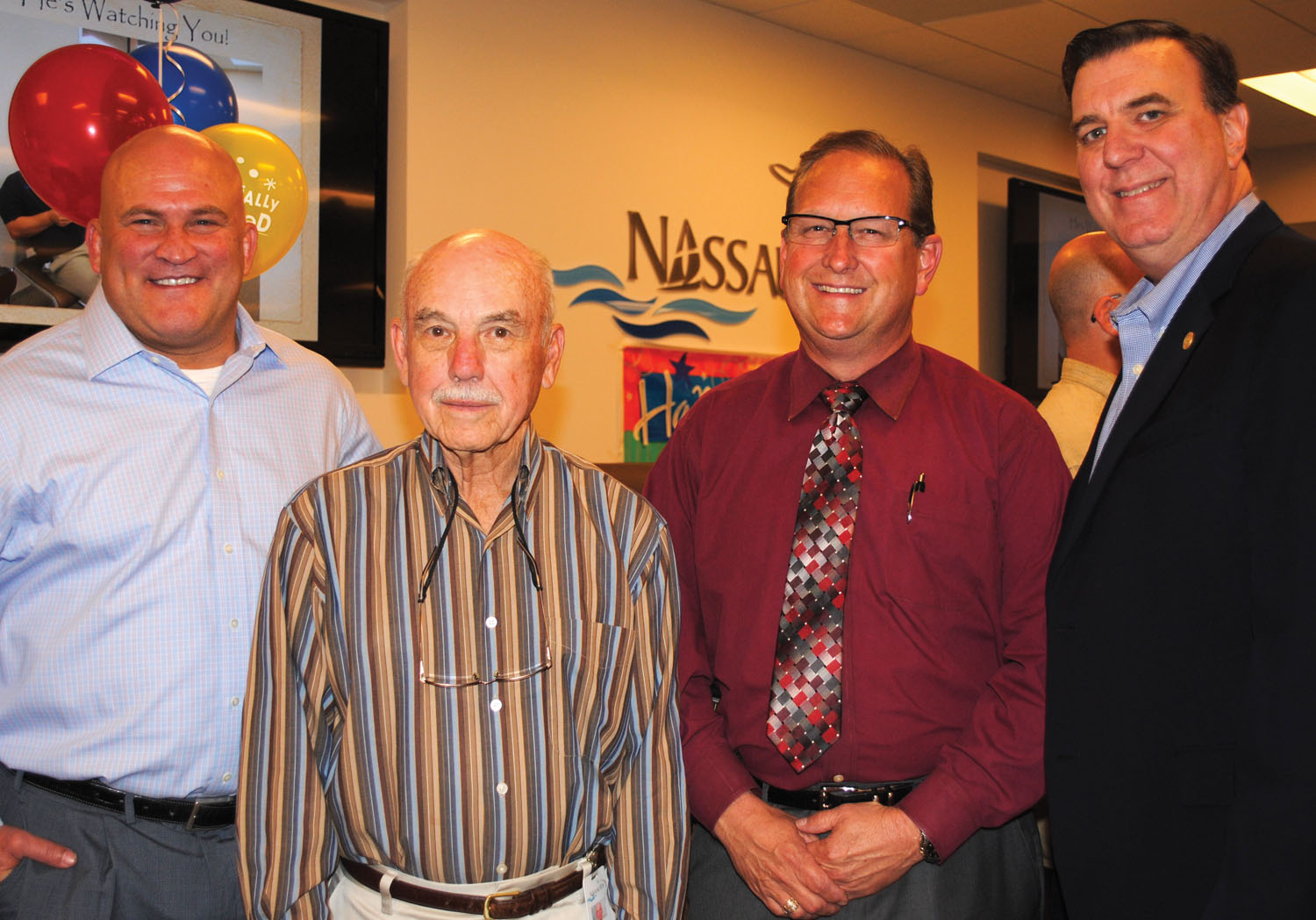 Former Nassau Bay City Manager Chris Reed, City Councilman Bob Warters, Constable Phil Sandlin and State Rep. Dennis Paul, from left, were among the hundreds who stopped by to say thank you to retiring Police Chief Joe Cashiola for his many years of work at farewell party the city hosted for him.