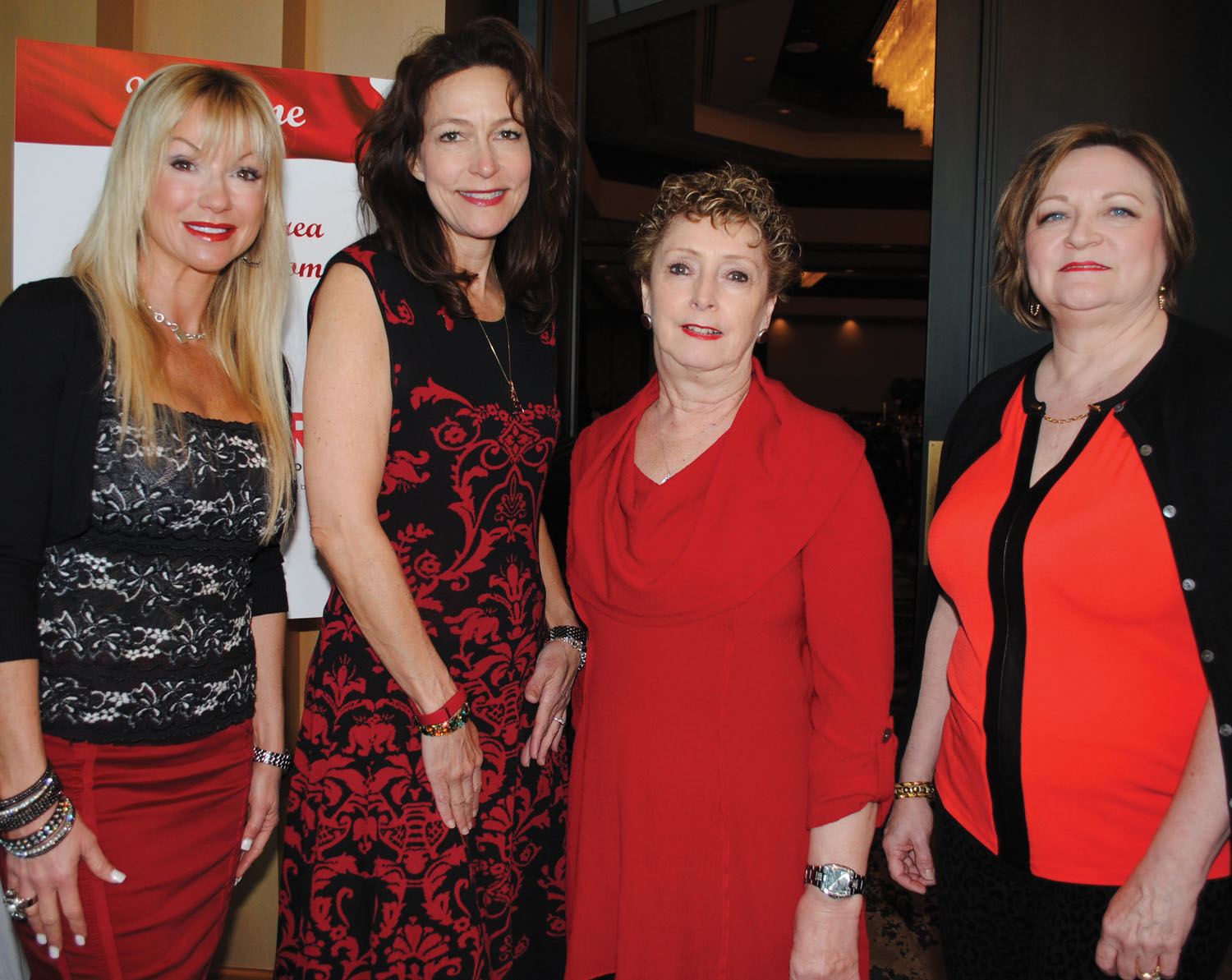 Kimberly Harding, Lauri Gordon, Susan White and Nancy Suarez, from left, were among several who spent many hours making the Go Red for Women event a big success.