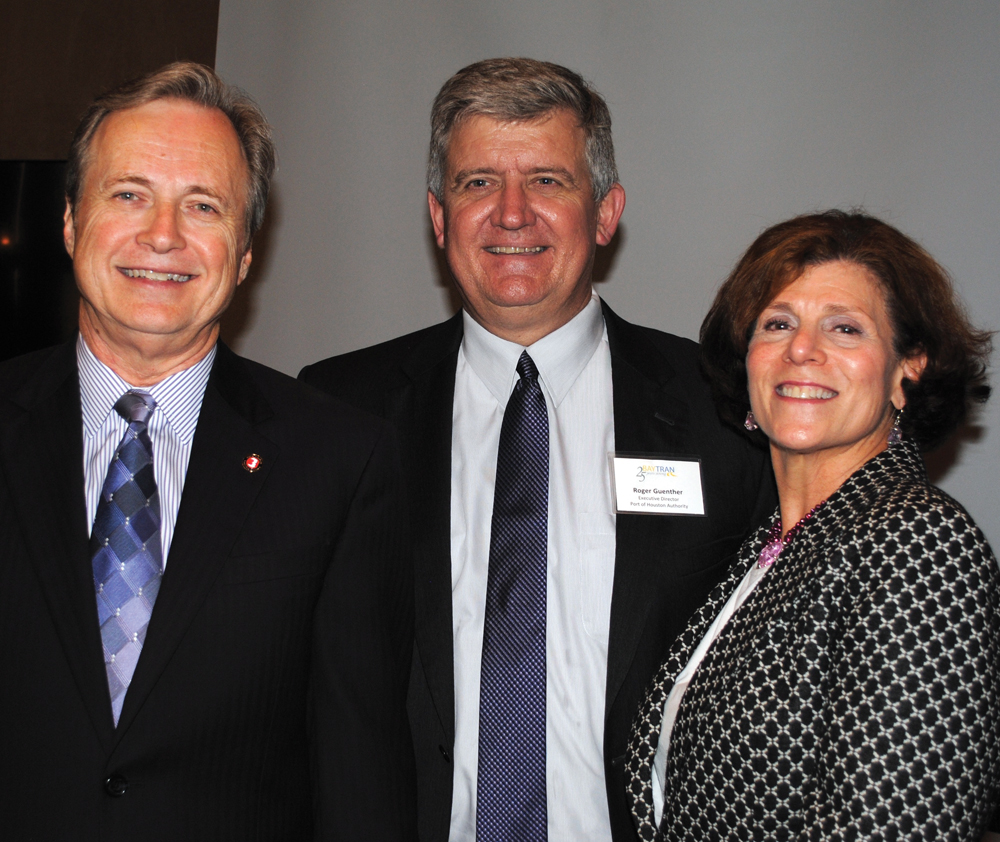 Port of Houston Executive Director Roger Guenther, who lives in Pearland, center, wears a big smile as BayTran President Barbara Koslov and BayTran Chairman David Hamilton welcome him to the State of the Port Luncheon.