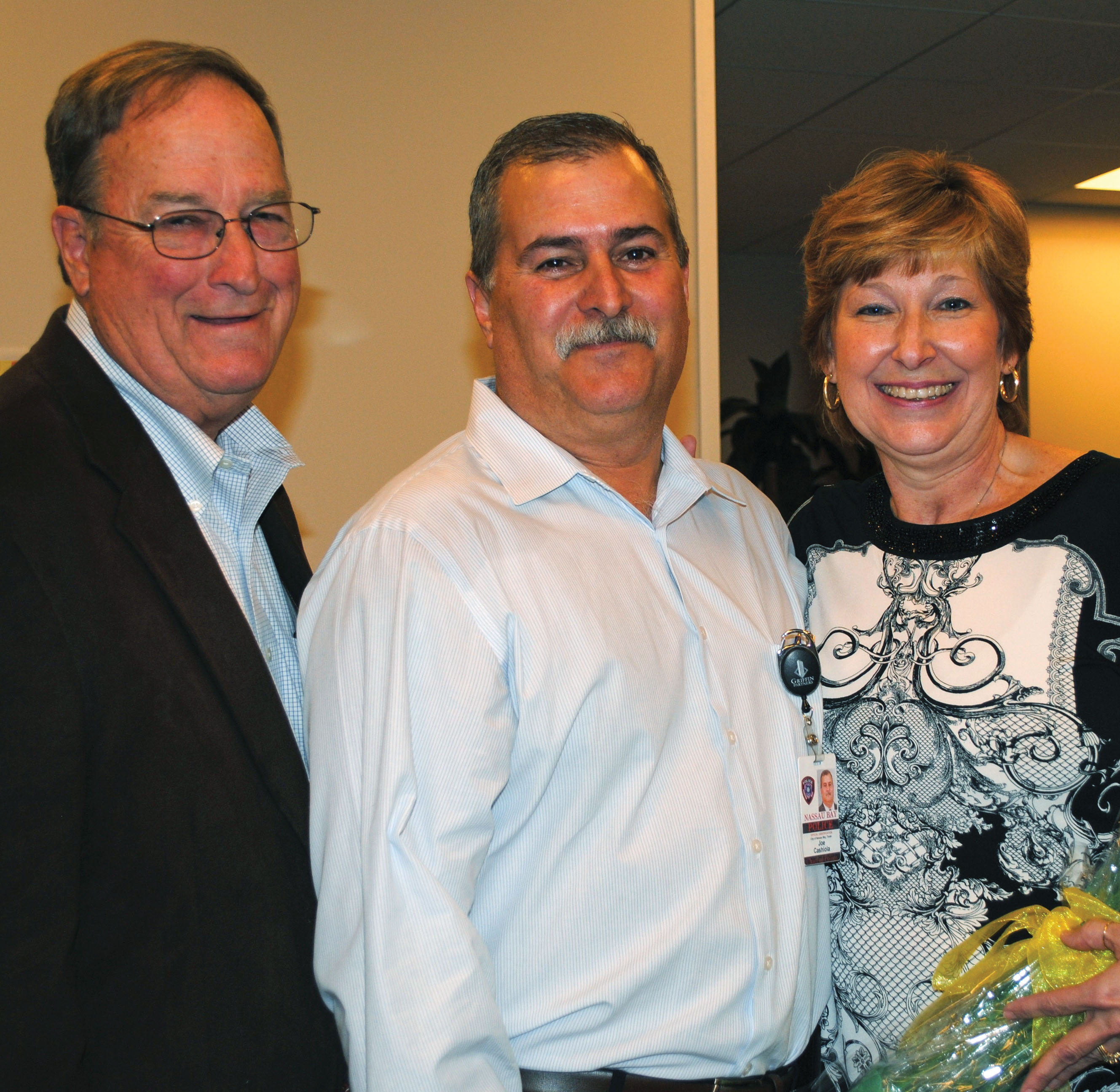 Retiring Nassau Bay Police Chief Joe Cashiola was honored at a farewell party at City Hall with hundreds of citizens dropping by. Former Mayor Don Matter, left, was among the many stopping by to wish the long-time chief and his wife well.