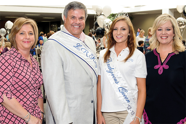 Lunar Rendezvous Festival General Chairman Terri Dieste, left, and Vice Chairman Jana Miller, right, join Festival Queen Caitlin Huston in congratulating Clear Creek ISD Superintendent Greg Smith on being chosen king of this year's summer extravaganza.
