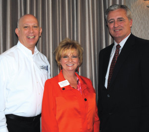 "Clear Lake Area Chamber President Cindy Harreld and Chairman-elect Roy Green, left, thank Col. Len Waterworth for speaking at the chamber luncheon and offering his perspective on ""Storm Surge Suppression."""