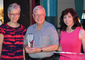 Hope Award winner Curt Tallman receives congratulations from Assistance League President Brunella Altemus, right, and Vice President Ann Marie Doolin during the presentation at the League Gala.