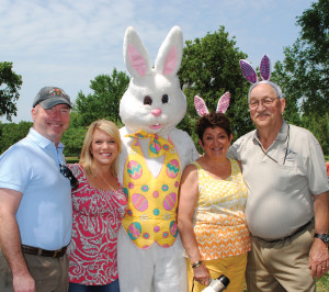 Jack and Margaret Ploss, right, Creekside Estates Easter Egg Hunt hosts, and their son and daughter-in-law, Greg and Pam Ploss, are pleased with both the weather and the crowd turnout for their annual event.