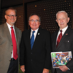 Pearland City Manager Clay Pearson, left, and Mayor Tom Reid stop to visit with UH-Clear Lake President Dr. Bill Staples at the University Community Partnership Breakfast.