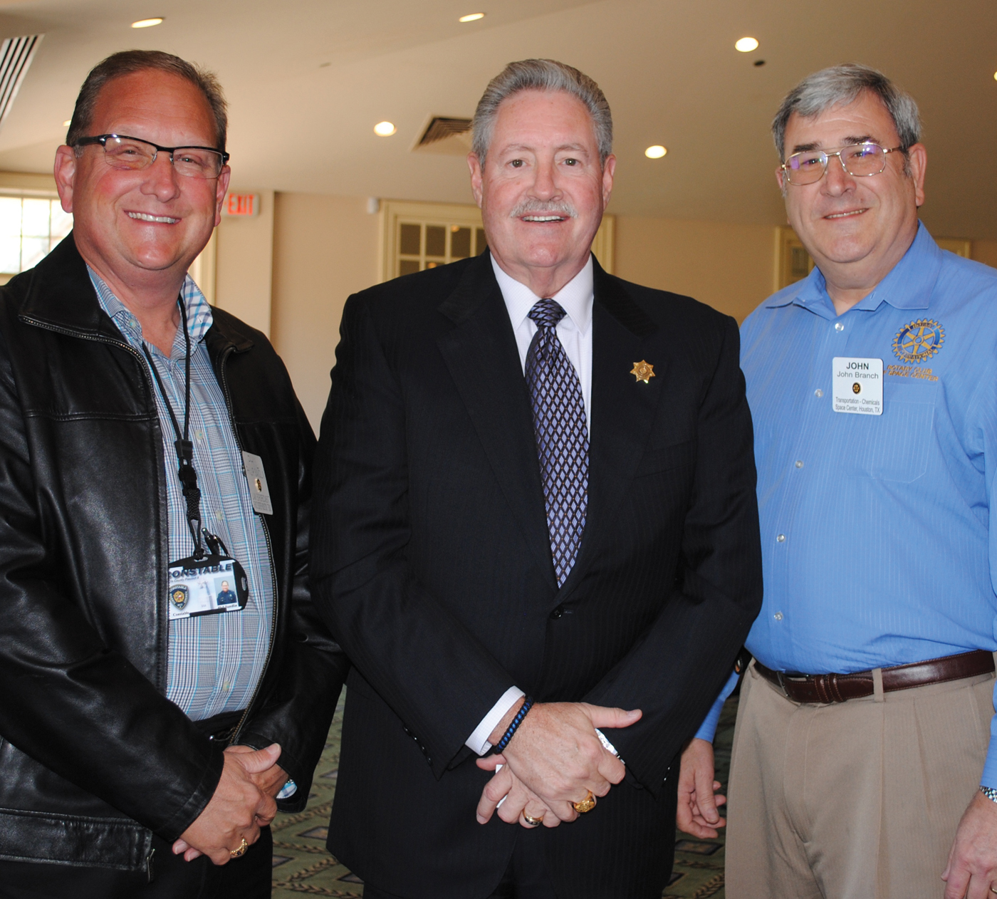 A new sheriff was the town the other day – Harris County Sheriff Ron Hickman, center, who came down to Clear Lake to speak at the Space Center Rotary Club luncheon at Bay Oaks Country Club. Here, Rotary President John Branch, right, and Precinct 8 Constable and Rotary member Phil Sandlin thank him for coming.