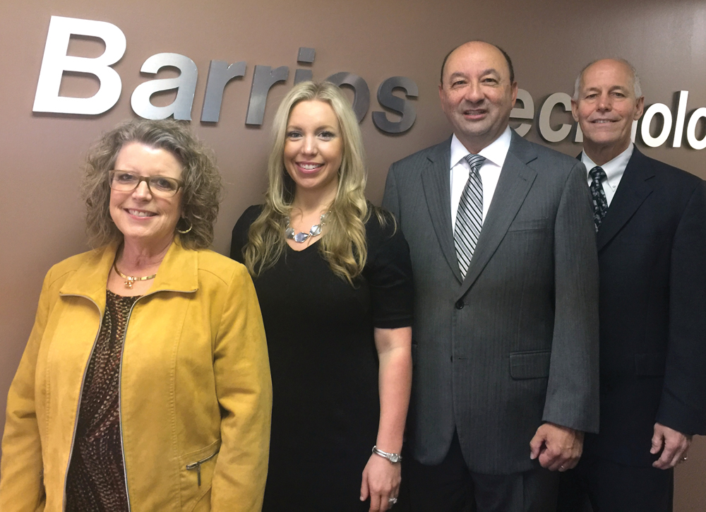 Barrios Technology CEO Sandy Johnson, from left, joins MAPI Mission Analysis and Integration Manager Kelly Page, MAPI Program Manager Mark Polansky and new Barrios President Robert McAfoos for a photo.