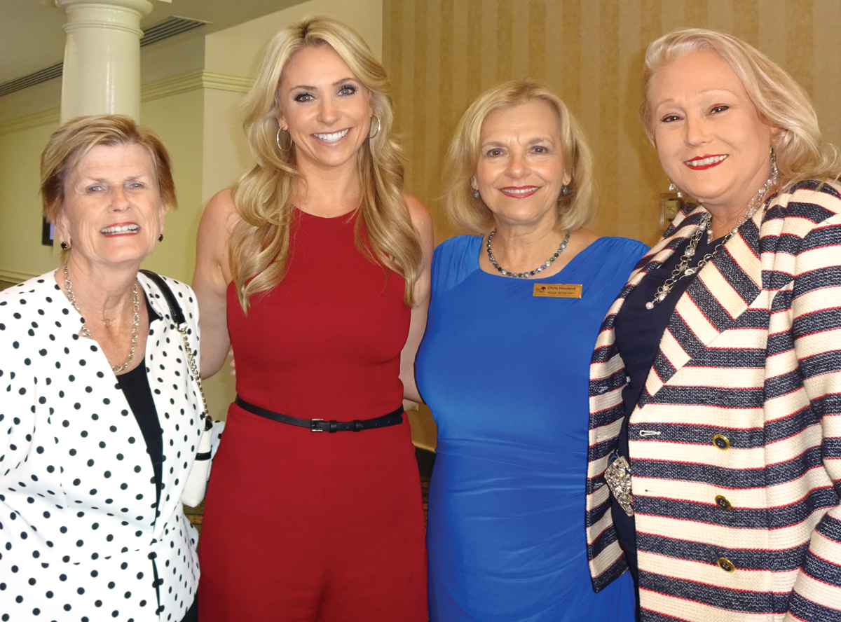 Ch. 11's Chita Johnson, second from left, gets a warm welcome from Jennie Hampton, Chris Howland and her grandmother-in-law, Annette Snow Falks, from left, as she arrives to address the Bay Oaks Women's Association luncheon at the country club.