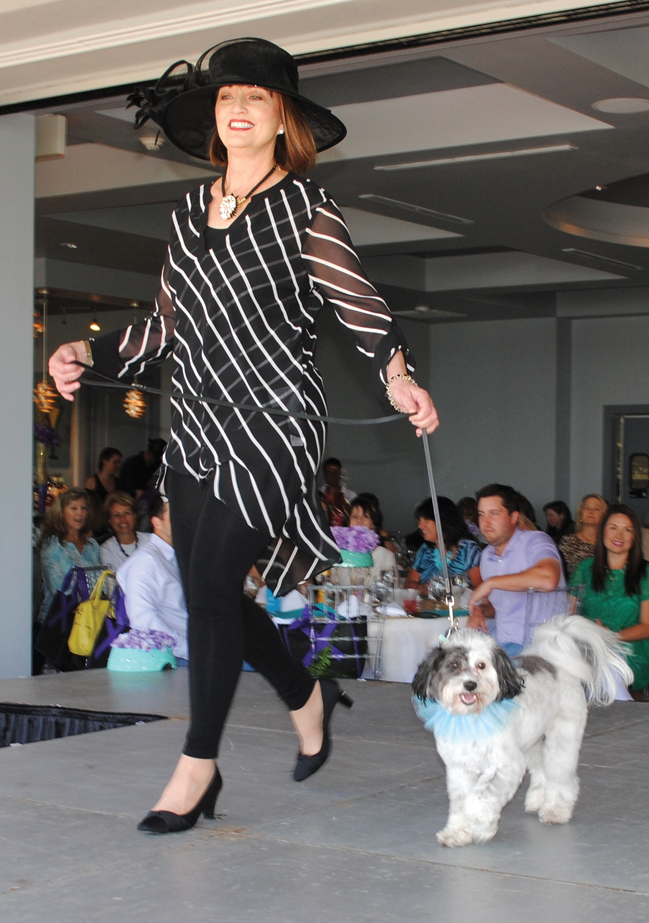 Dogs & Diva model and her companion come down the runway. Photo by Mary Alys Cherry.