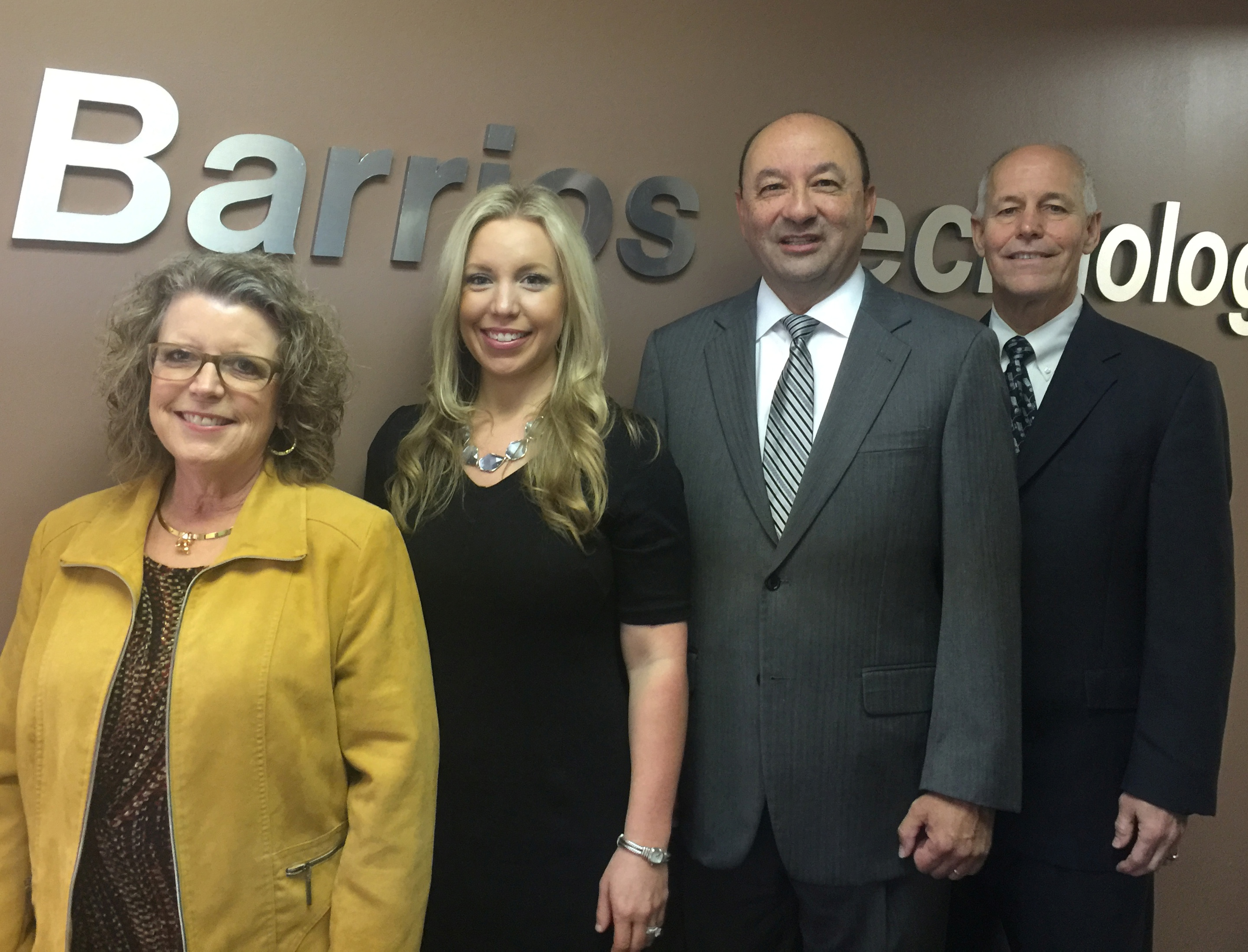 Houston based Barrios Technology announces executive leadership changes at their corporate office and with their prime Johnson Space Center International Space Station Program Mission and Program Integration contract.  Pictured, from left, are Barrio CEO Sandy Johnson; Kelly Page, MAPI Mission Analysis and Integration Manager Barrios Technology; Mark Polansky, MAPI Program Manager Barrios Technology; and Robert McAfoos, President Barrios Technology.