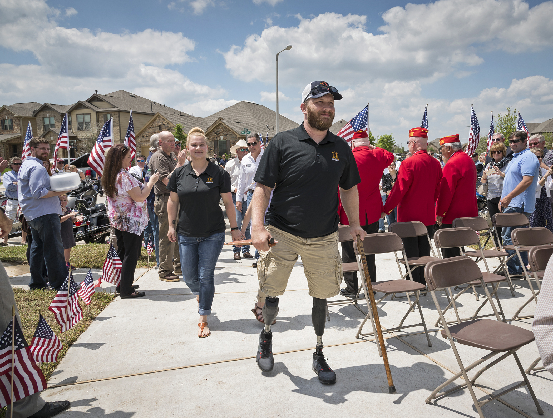 Marine Cpl. Jonathan Dowdell and his wife, Rebecca, walk up the driveway of their new Tuscan Lakes home for the first time.