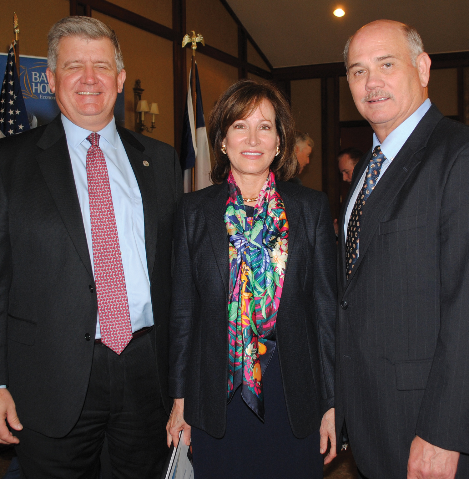 Bay Area Houston Economic Partnership President Bob Mitchell, right, visits with Port of Houston Executive Director Roger Guenther and Port Commission Chairman Janiece Longoria during BAHEP's State of the Port meeting at Lakewood Yacht Club.