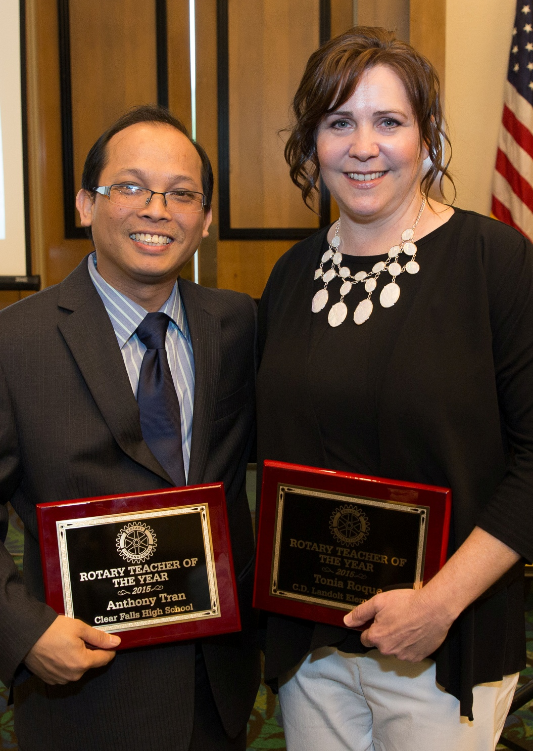 CCISD Teachers of the Year Anthony Tran of Clear Falls High and Tonia Roque of Landolt Elementary  show off the plaques they were presented at the luncheon at South Shore Harbour.