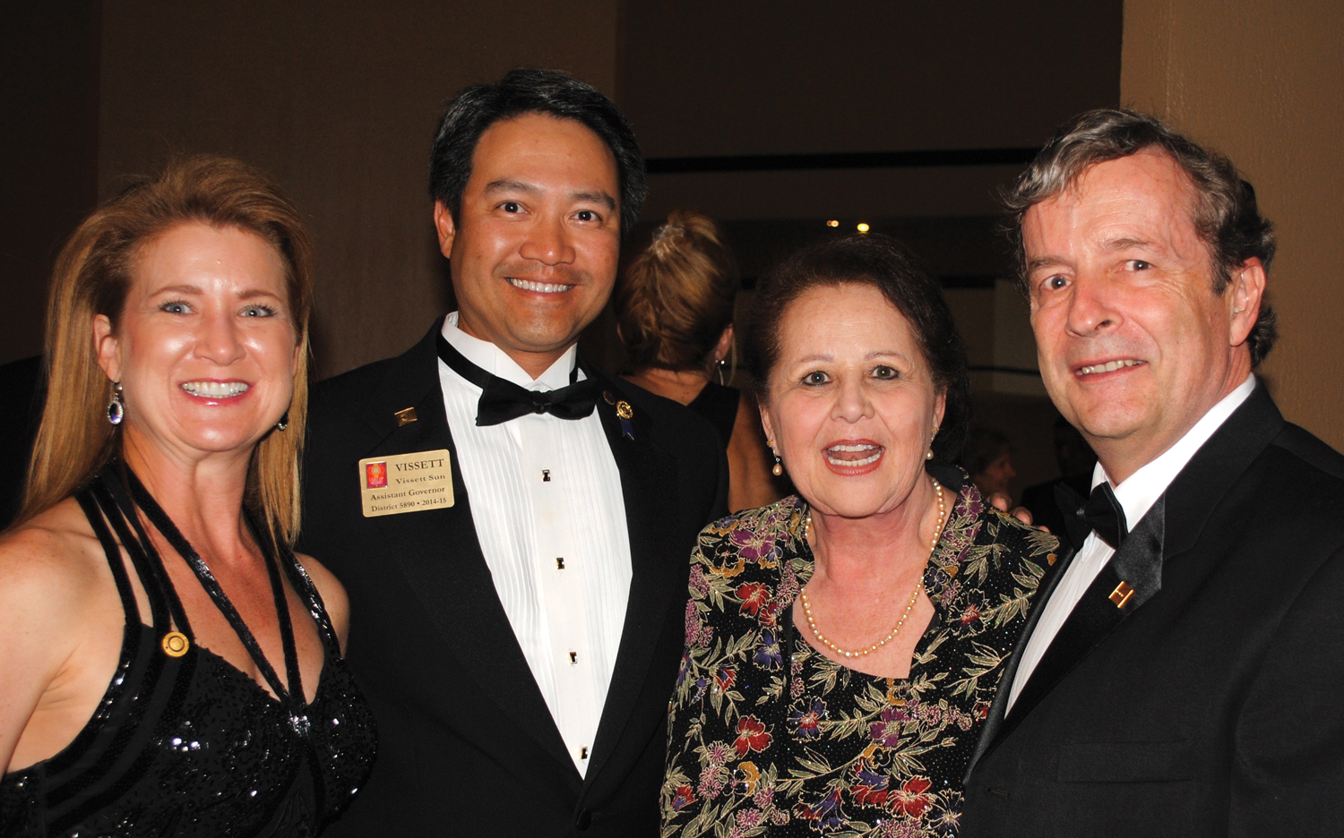 Dr. Vissett Sun and his wife, Adrienne, left, talk over old times with Donnie Johnson and Geoff Atwater at the Space Gala. Sun, Johnson and Atwater are all former Space Center Rotary presidents.