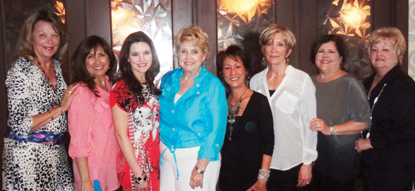 Martha Ferebee, fourth from left, is greeted on arrival at her 75th birthday celebration at Perry's Italian Restaurant by long-time pals, from left, Alice Marinos, Angie Weinman, Tonya Ferris, Ava Galt, Kay Smith, Ann Wismer and Betsy Bush.