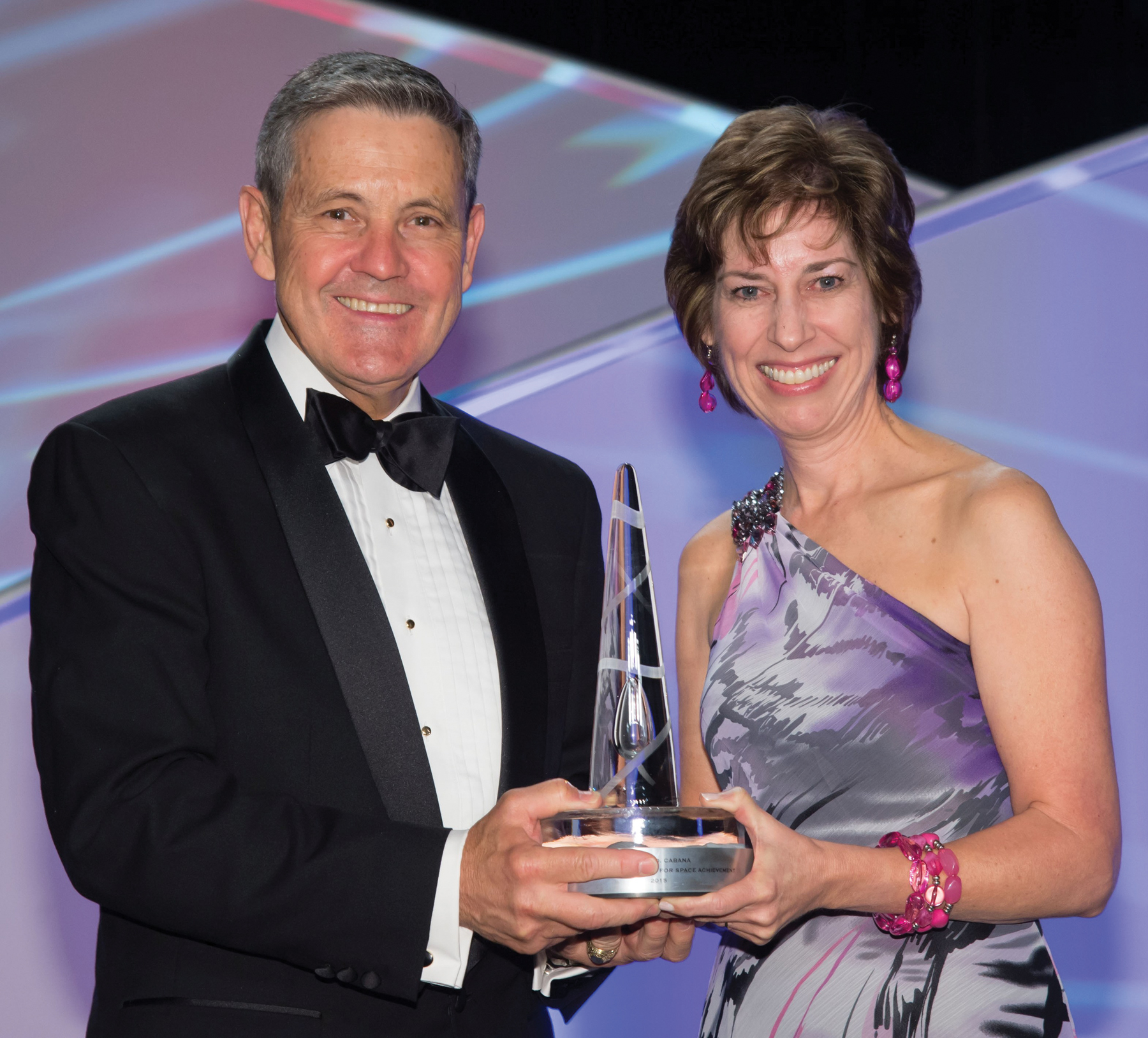 Johnson Space Center Director Dr. Ellen Ochoa presents the coveted National Space Trophy to Kennedy Space Center Director Robert Cabana during ceremonies at the Rotary National Award for Space Achievement Foundation's 29th annual Space Gala at the Downtown Houston Hyatt Regency. Photo: NASA