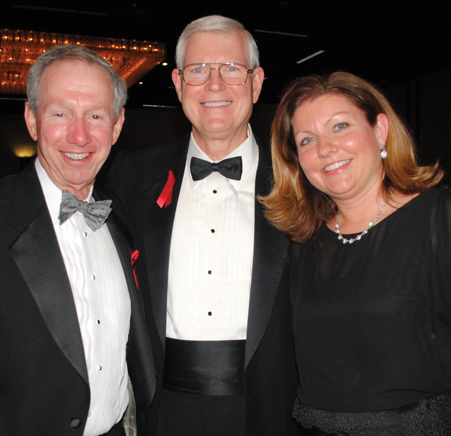 The 2012 Space Trophy winner and retired JSC Director Mike Coats, and his daughter, Lauren Larkin, right, visit with former NASA Administrator Dr. Michael Griffin, the 2009 Space Trophy winner who came up from Huntsville, Ala., for the Space Gala.