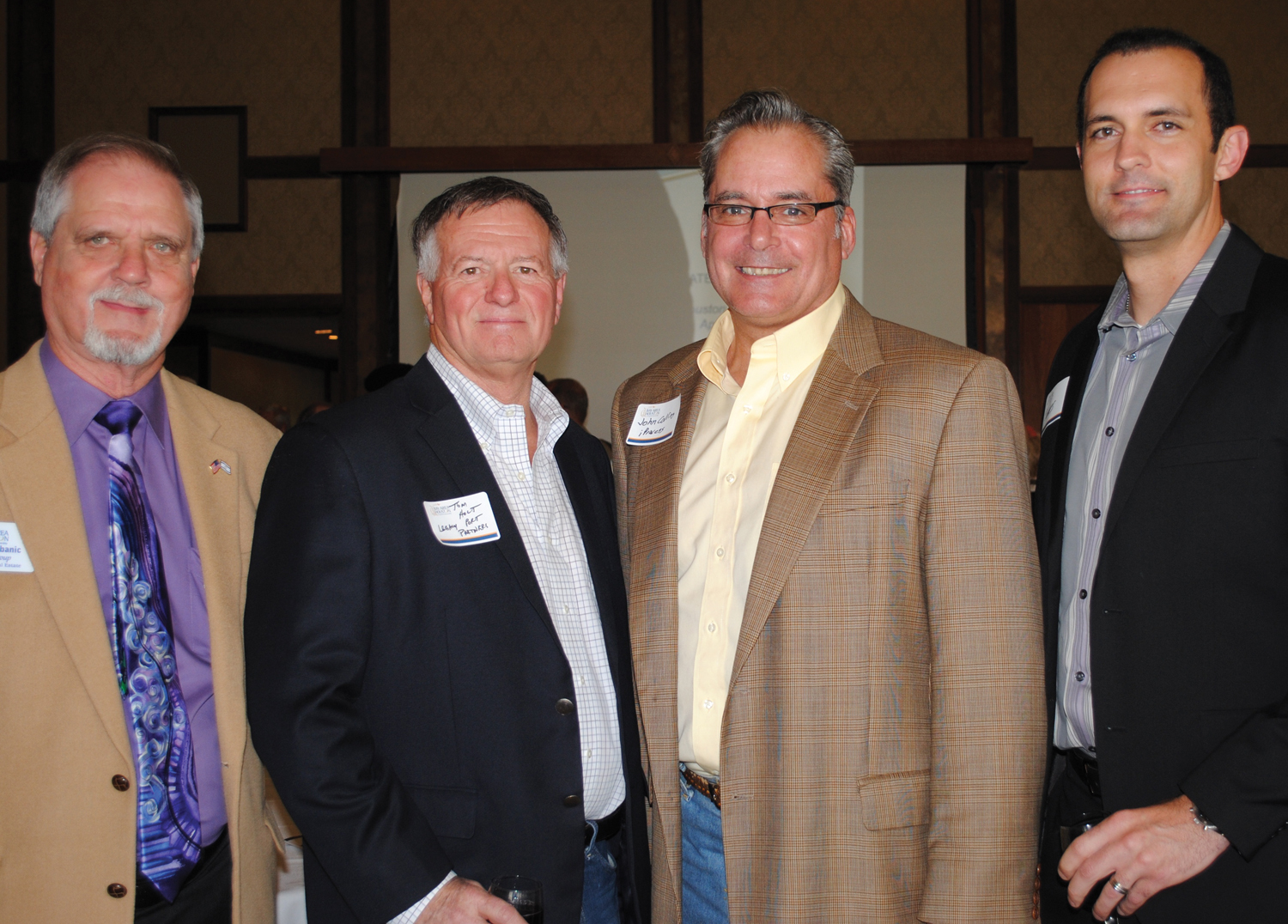 Simon Urbanic, Tom Holt, John Collins and James Waguespark, from left, were among the many attending the Bay Area Houston Economic Partnership State of the Port meeting at Lakewood Yacht Club.