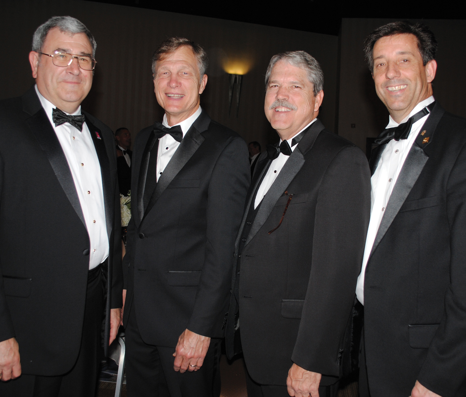 Space Center Rotary President Scott Rainey, right, and President-elect John Branch, from left, welcome Congressman Dr. Brian Babin and State Sen. Larry Taylor to the 29th Annual Rotary Space Gala.