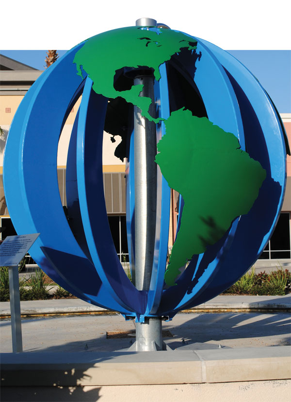 Statue of Planet Earth, rotating with the wind near the entrance of the space sculpture garden, is one of the most colorful on the Town Square plaza.