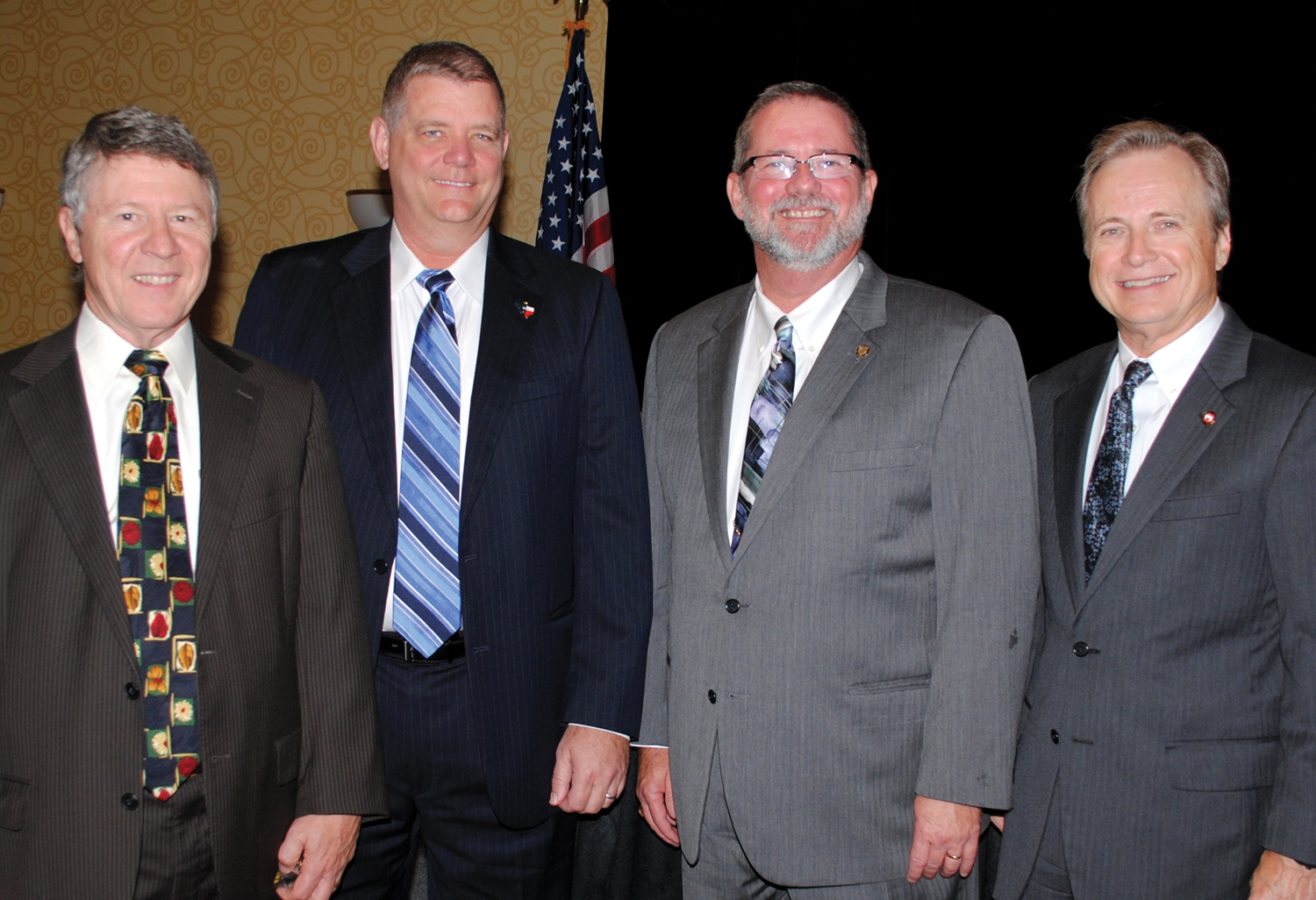 BayTran Chairman David Hamiton, right, thanks Harris County Judge Ed Emmett, Galveston County Judge Mark Henry and Brazoria County Judge Mark Sebesta, from left, for participating in the 17th annual State of the Counties Luncheon at the Hobby Marriott Hotel.