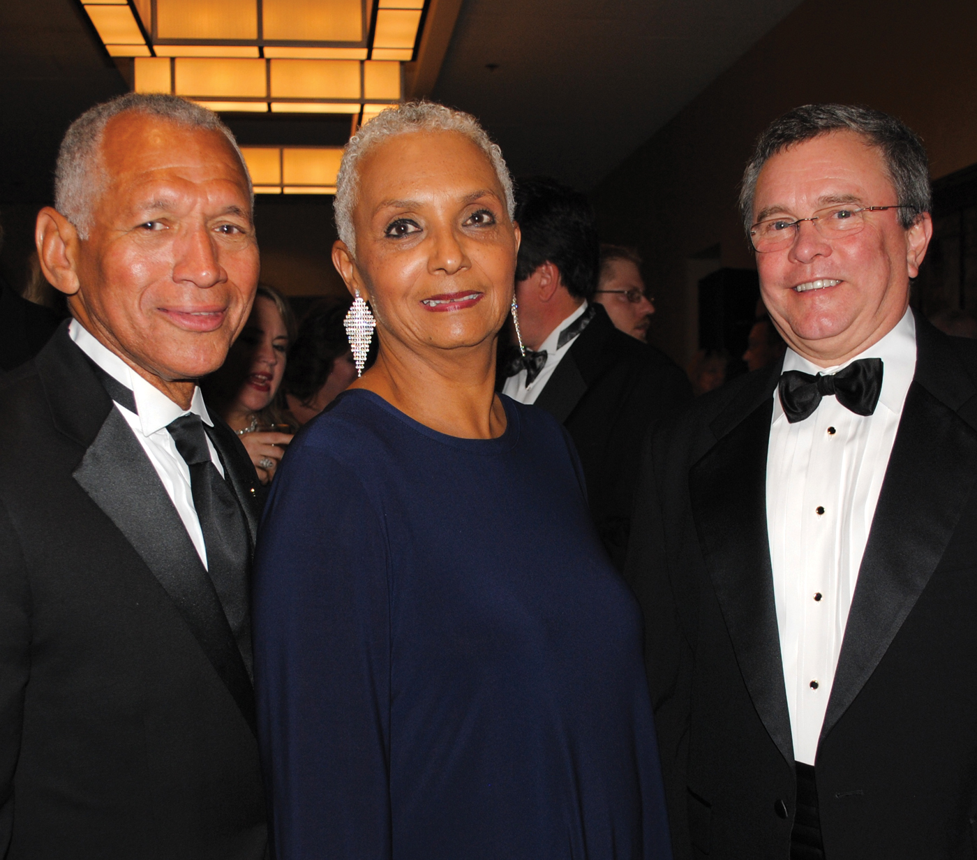 NASA Administrator Charles Bolden and his wife, Jackie, left, visit with Dr. Jeffrey Davis, JSC human health director, as they await the start of the Rotary Space Gala.