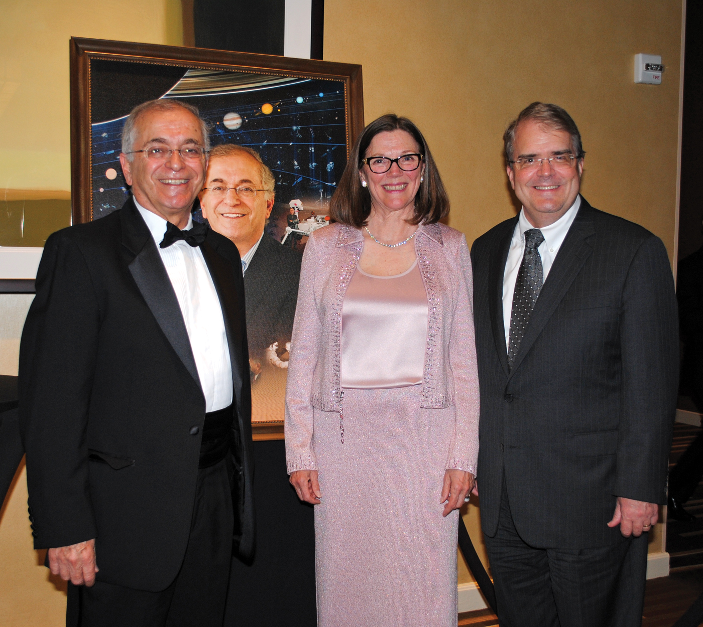 Space Trophy winner Dr. Charles Elachi and his wife, Valerie, left, receive congratulations from Texas Congressman John Culberson as they arrive at the Hyatt Regency for the Rotary Space Gala.