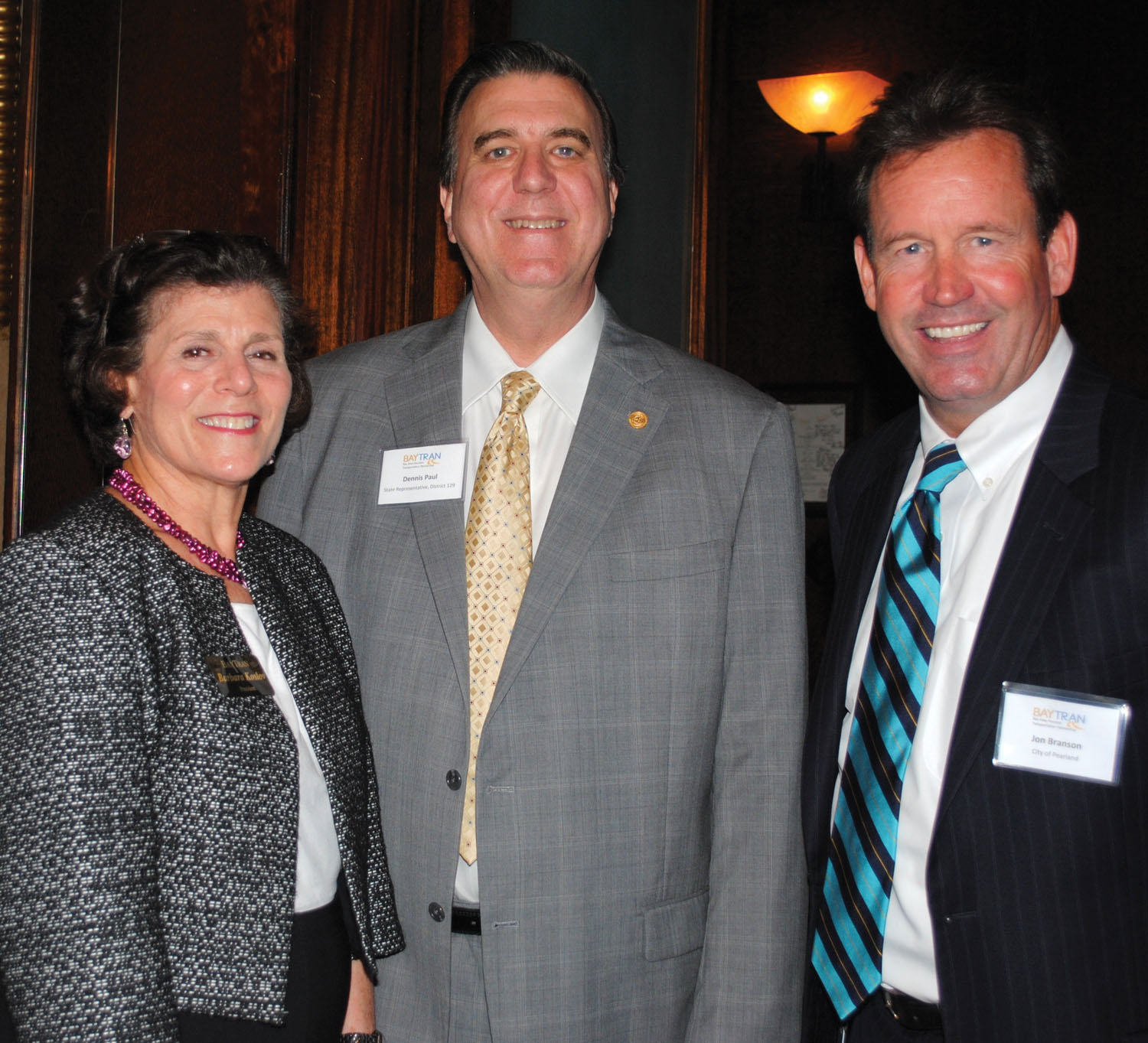 BayTran President Barbara Koslov and Chairman Jon Branson, right, welcome State Rep. Dennis Paul to the June 18 monthly luncheon at Cullen's Upscale Grille.