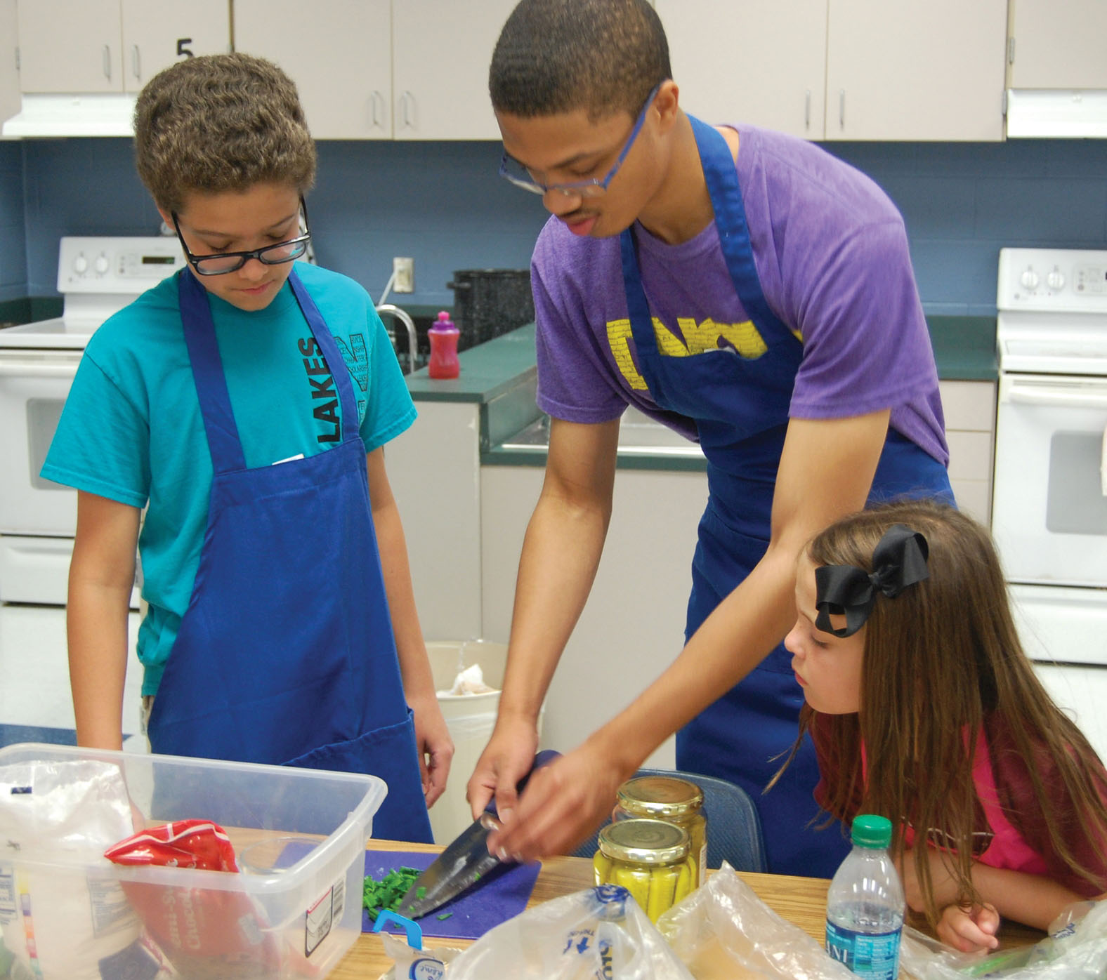 CCISD studentsColt Schultz, Ihsaan Muhammod and Avery Douglas, from left, team up to create a tasty culinary delight.