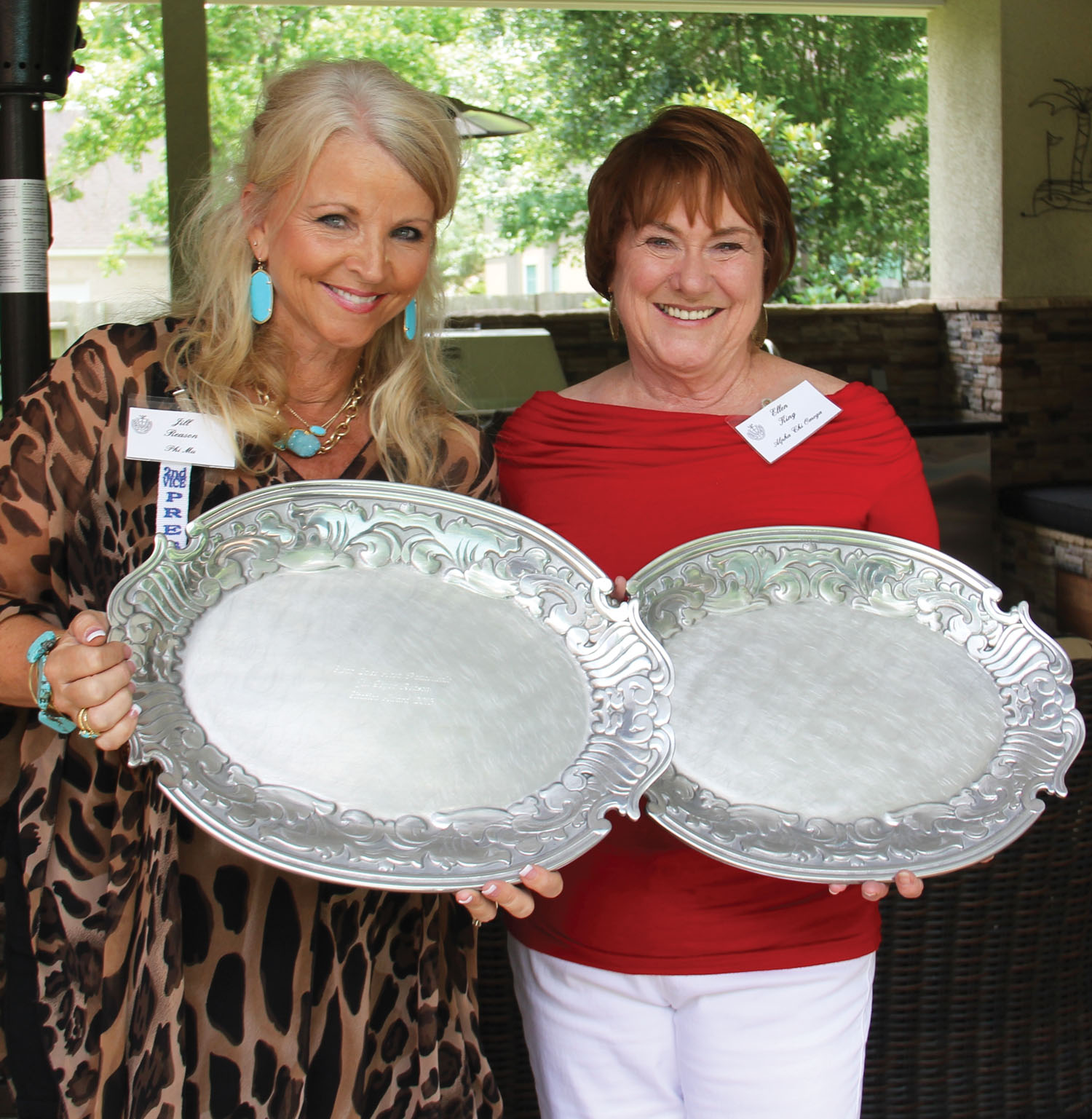 Citation Award winners Jill Reason, left, and Ellen King wear big smiles after receiving their Clear Lake Panhellenic awards at this year's May luncheon.