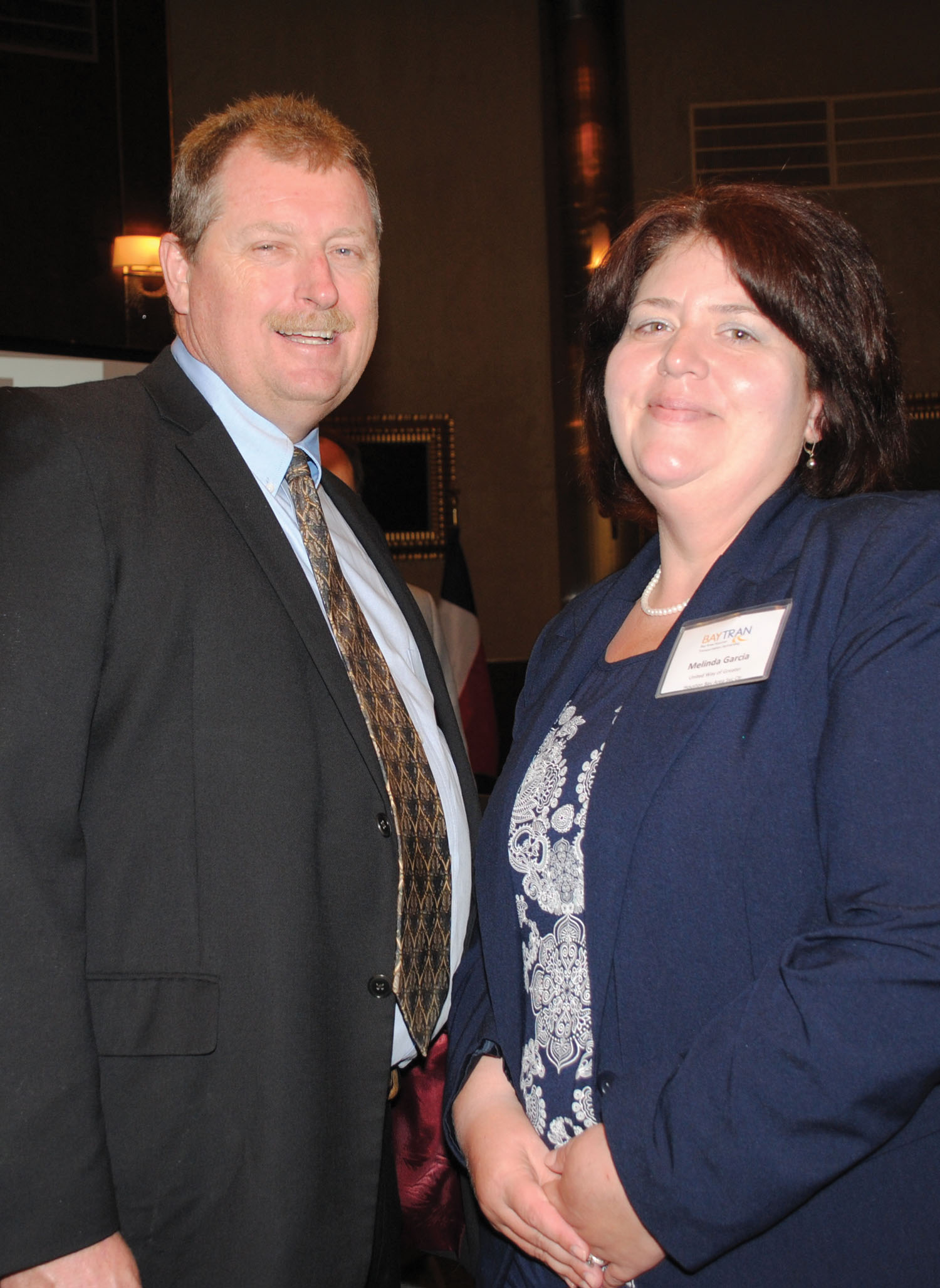 Galveston County Commissioner Ken Clark and United Way Executive Director Melinda Garcia,