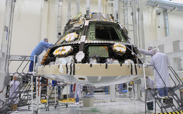 NASA and Lockheed Martin engineers have installed the largest heat shield ever constructed on the crew module of the agency's Orion spacecraft.