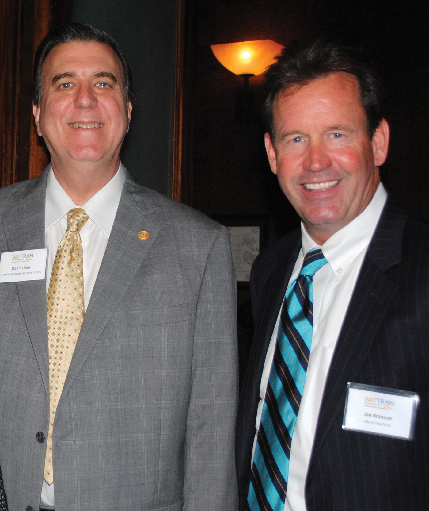 Pearland Deputy City Manager and BayTran Chairman Jon Branson, right, welcomes State Rep. Dennis Paul to the luncheon at Cullen's Upscale Grille.