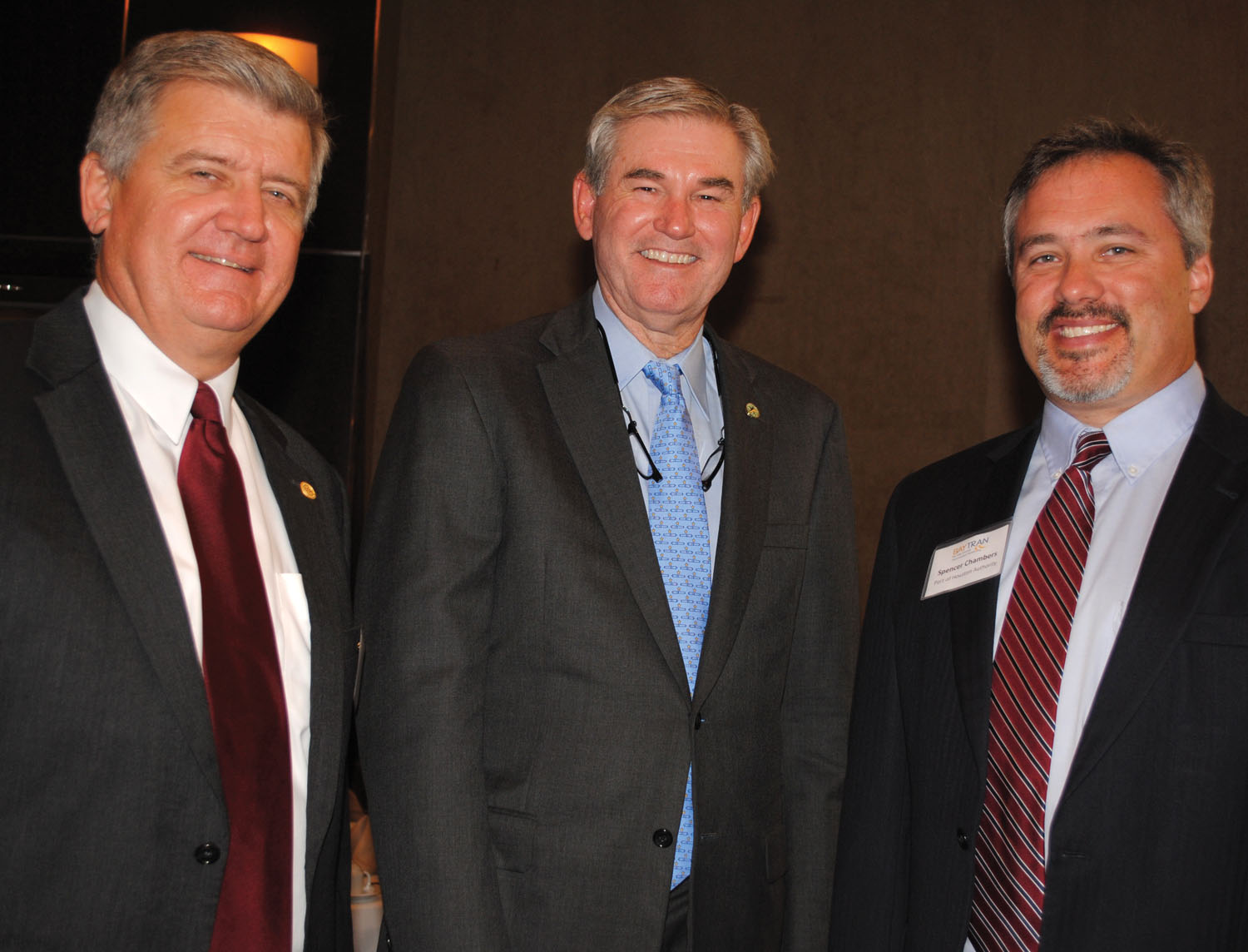 State Rep. Ed Thompson, center, stops for a visit with Port of Houston Executive Director Roger Guenther, left, and the Port's Director of Governmental Relations Spencer Chambers, a BayTran Board member, at the BayTran monthly luncheon at Cullen's.