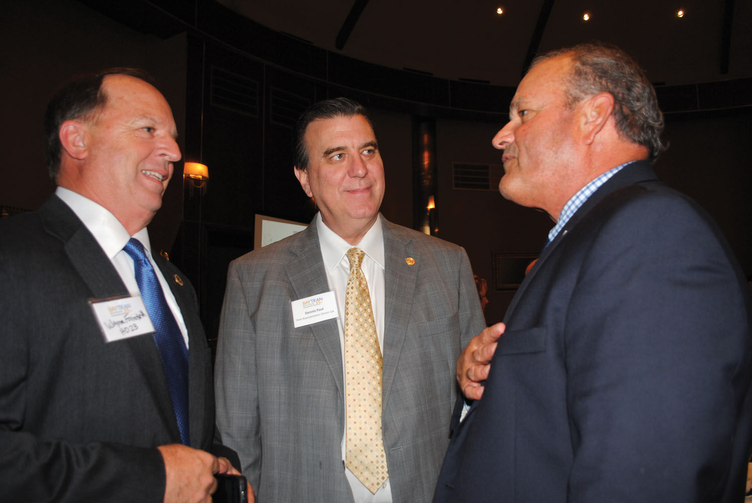 State Rep. Wayne Faircloth and Dennis Paul, from left, talk about the recent legislative session with TxDOT Executive Director Lt. Gen. Joe Weber during the Bay Area Houston Transportation Partnership's monthly luncheon June 18 at Cullen's.