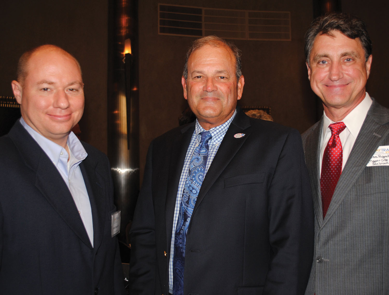 TxDOT Executive Director Lt. Gen. Joe Weber, center, talks with Kemah City Administrator Rick Beverlin, left, and Seabrook Mayor Glenn Royal after addressing the Bay Area Houston Transportation Partnership luncheon at Cullen's Upscale Grille.