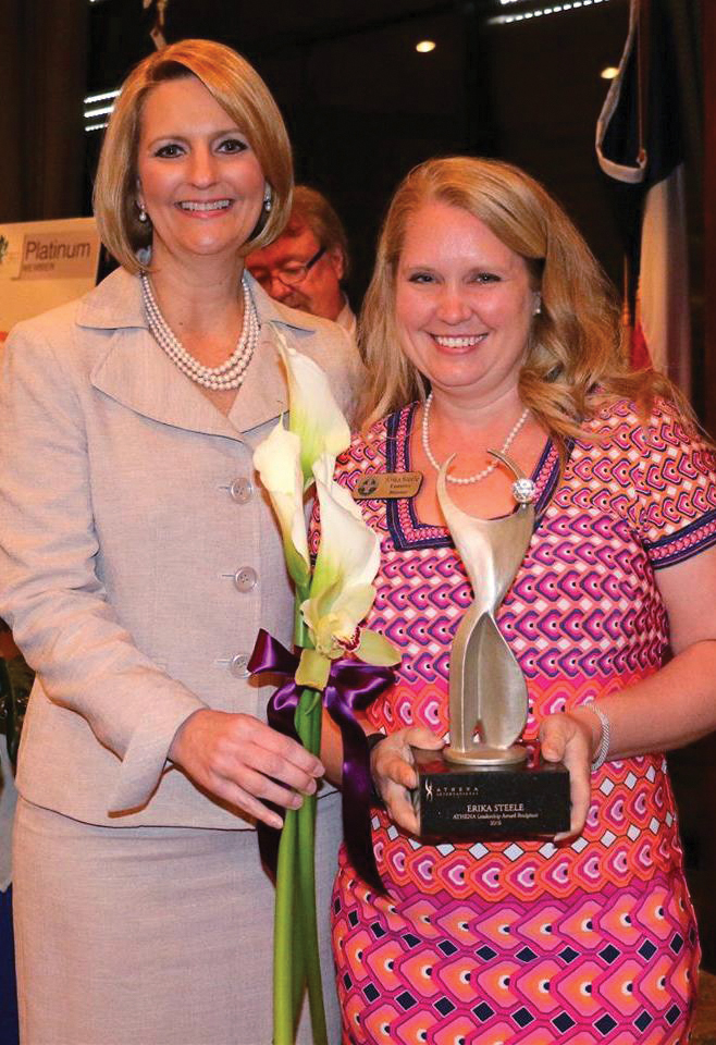 Erika Steele, right, is presented the 2016 Athena Leadership Award by Jill Kaiser, chairman of the League City Regional Chamber Board of Directors.