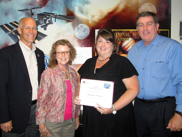 Barrios employee Suzanne Domin, third from left, is presented a First Quarter Silver Bear Award. Joining in the presentation are, from left, are Barrios Program Manager Robert McAfoos, Barrios President and CEO Sandy Johnson and Deputy Manager Kirk Shireman, ISS Program. Domin was one of five employees recognized.